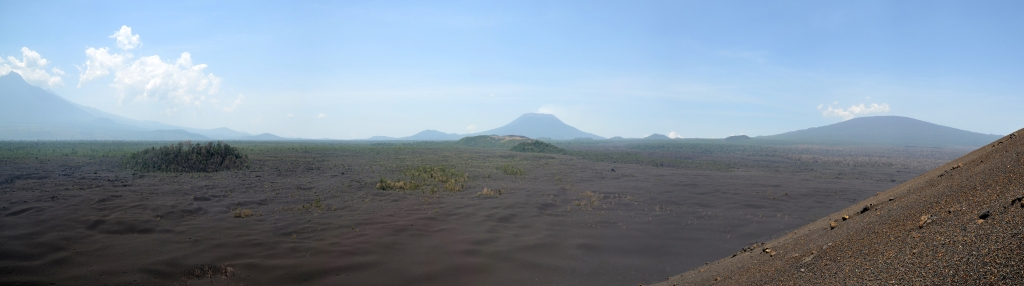 Panoramic view from the 2011-2012 eruptive site of Nyamulagira. From left to right: Mikeno, Nyiragongo and Nyamulagira volcanoes. Photo (c) B. Smets, 2012.