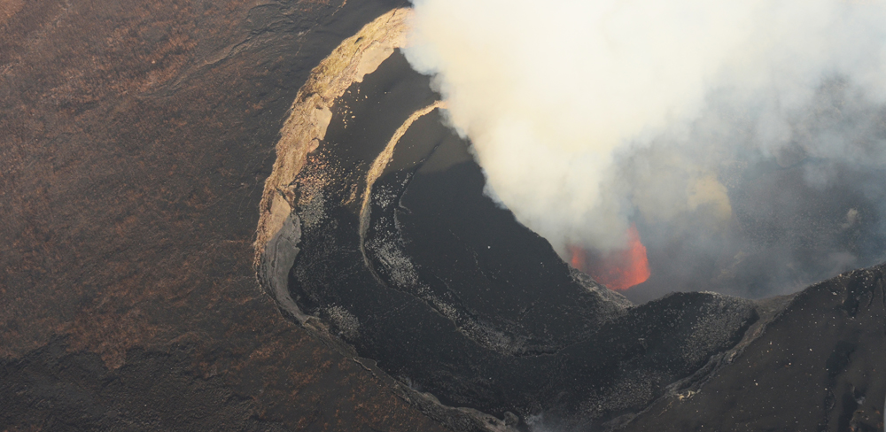 Fire fountains observed in the pit crater located in the NE part of the Nyamulagira caldera, on 1st July 2014. Photo (c) B. Smets